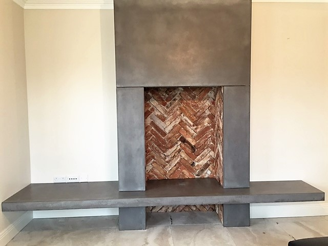 Polished Concrete Fireplace With Reclaimed Brick Feature