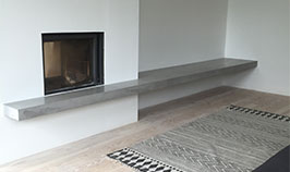 Polished concrete fireplace shelf